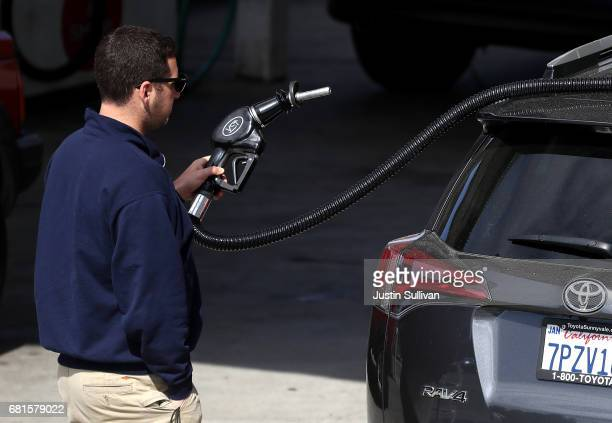 A customer prepares to pump gasoline into his car at a gas station on May 10 2017 in San Anselmo California California Gov Jerry Brown is set to...