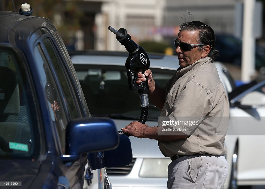 A customer prepares to pump gasoline into his car at an Arco gas station on March 3, 2015 in Mill Valley, California. U.S. gas prices have surged an average of 39 cents in the past 35 days as a result of the price of crude oil prices increases, scheduled seasonal refinery maintenance beginning and a labor dispute at a Tesoro refinery. It is predicted that the price of gas will continue to rise through March.