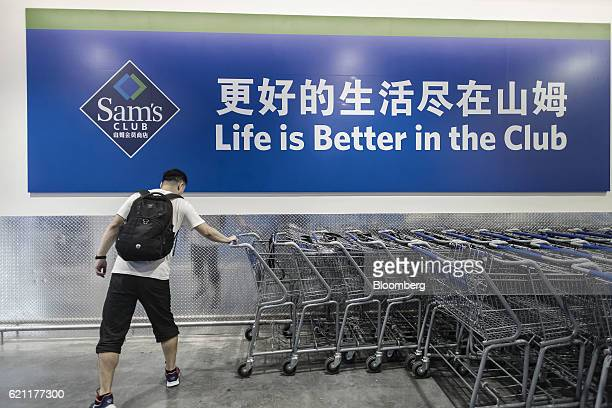 A customer pulls out a shopping cart inside a WalMart Stores Inc's Sam's Club store in Zhuhai China on Friday Oct 14 2016 WalMart sees big potential...