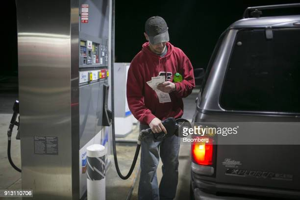 A customer pumps fuel into a vehicle at a Chevron Corp gas station in Eastanollee Georgia US on Monday Jan 29 2018 Chevron Corp is scheduled to...