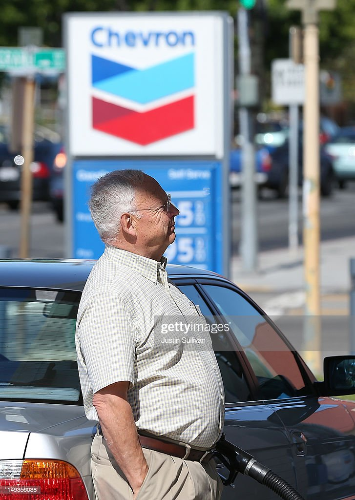 A customer pumps gas into his car at a Chevron gas station on July 27, 2012 in San Rafael, California. Chevron reported a 6.8 percent decline in second quarter earnings with profits of $7.21 billion compared to $7.73 billion one year ago.