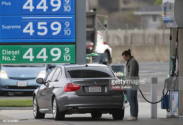 A customer pumps gas into his car at a Chevron gas station on July 3 2014 in Mill Valley California As the conflict in Iraq coninutes to escalate gas...