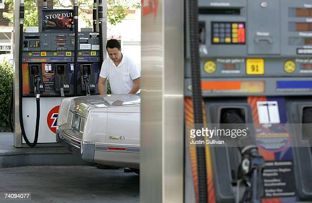 A customer pumps gasoline at a service station May 7 2007 in San Francisco California Gas prices reached a record national average price of $307 per...
