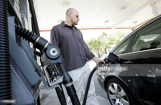 A customer pumps gasoline into his car at a service station May 7 2007 in San Francisco California Gas prices reached a record national average price...