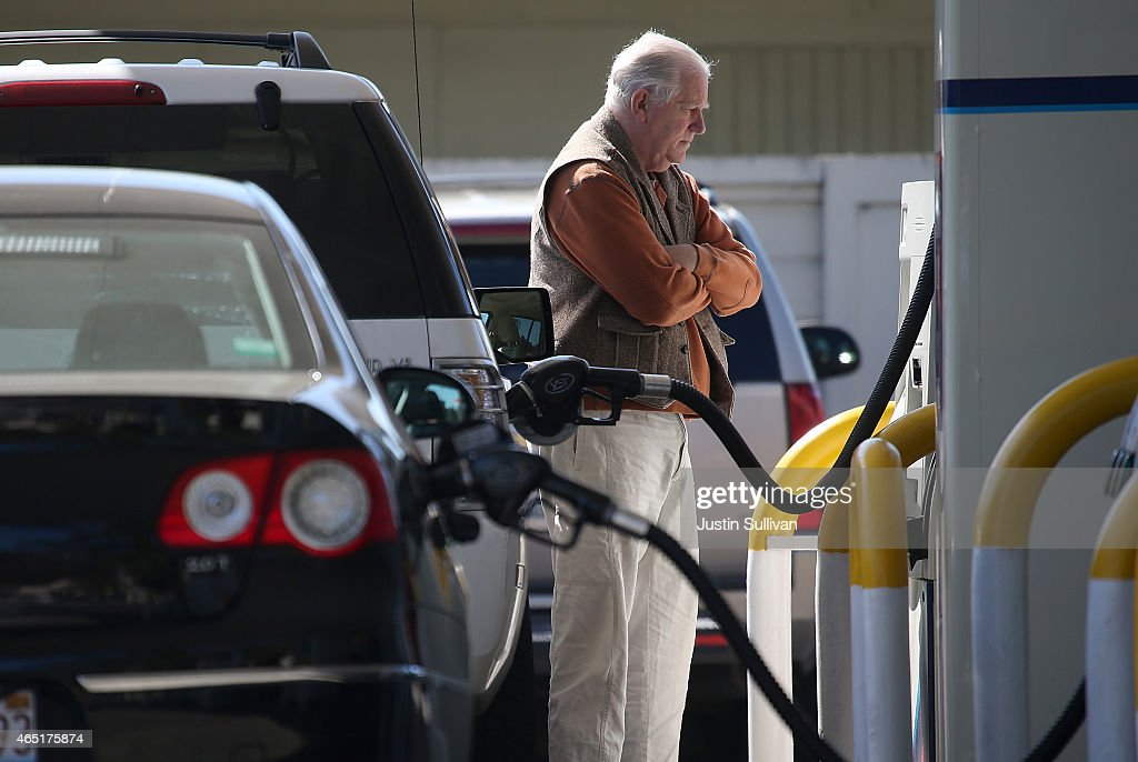 A customer pumps gasoline into his car at an Arco gas station on March 3, 2015 in Mill Valley, California. U.S. gas prices have surged an average of 39 cents in the past 35 days as a result of the price of crude oil prices increases, scheduled seasonal refinery maintenance beginning and a labor dispute at a Tesoro refinery. It is predicted that the price of gas will continue to rise through March.