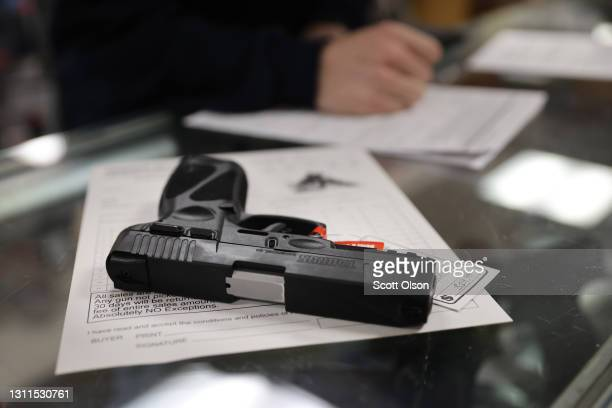 Customer purchases a gun at Freddie Bear Sports on April 08, 2021 in Tinley Park, Illinois. President Joe Biden today announced gun control measures...