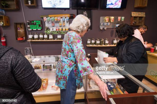 A customer purchases cannabis products at the Green Pearl Organics dispensary on the first day of legal recreational marijuana sales in California...