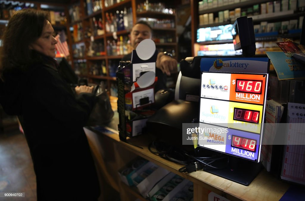A customer purchases lottery tickets at a convenience store on January 3, 2018 in San Francisco, California. The Powerball jackpot and Mega Millions jackpots are both over $400 million at the same time for the first time. The Mega Millions $418 million jackpot would be the fourth largest and the $460 million Powerball jackpot would be the seventh largest in the game's history.