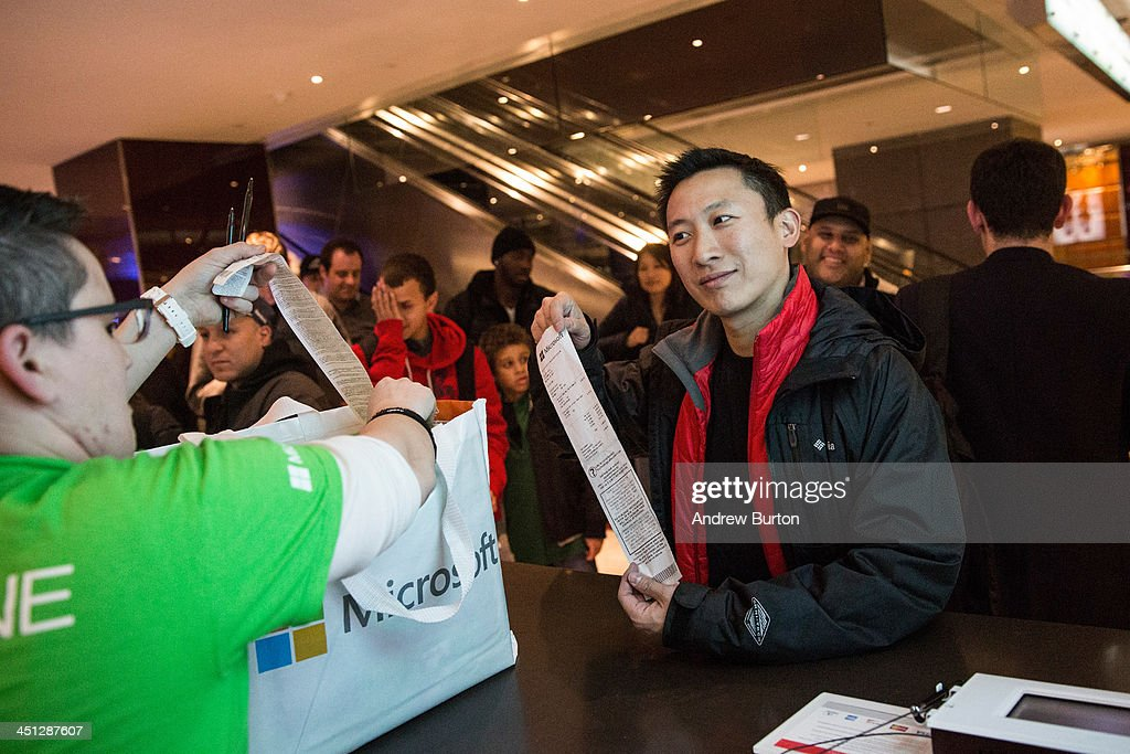 A customer purchases Microsoft's XBox One, a new video game console and home entertainment system, from a Microsoft ''pop-up shop'' at the Time Warner Center at Columbus Circle on 22, 2013 in New York City. The X Box One arrives just in time for the holiday season, and will be competing against the Sony Playstation Four, which came out last week.