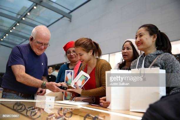 A customer purchases the new iPhone X at an Apple Store on November 3 2017 in Palo Alto California The highly anticipated iPhone X went on sale...