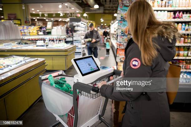 A customer pushes a Caper Inc smart shopping cart at a Foodcellar Co grocery store in the Long Island City neighborhood in the Queens borough of New...