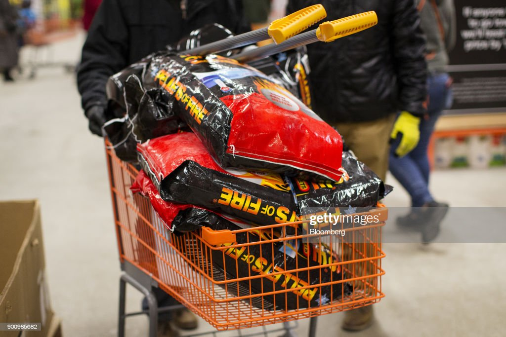 A customer pushes a shopping cart filled with snow shovels and packages of ice melter at a Home Depot Inc. store in Boston, Massachusetts, U.S., on Wednesday, Jan. 3, 2018. The worst winter storm of the season has already knocked out power and canceled more than 1,600 flights. Next it threatens to bring more snow, ice and cold from Florida to Nova Scotia, including New York and Boston. Photographer: Adam Glanzman/Bloomberg via Getty Images