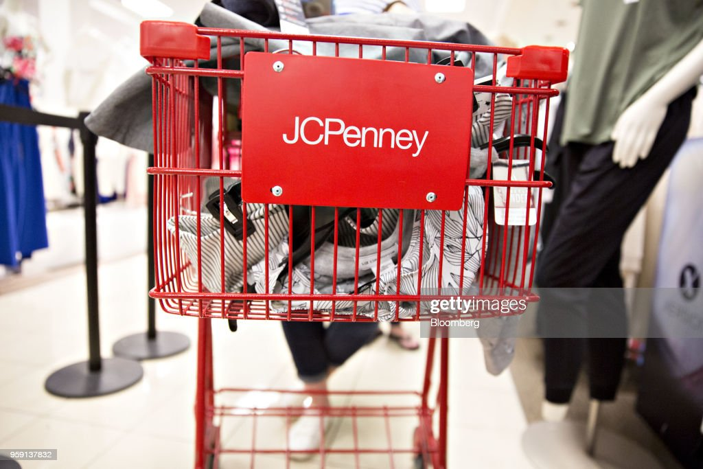 A customer pushes a shopping cart inside a J.C. Penney Co. store in Peoria, Illinois, U.S., on Saturday, May 12, 2018. J.C. Penney Co. is scheduled to release earnings figures on May 17. Photographer: Daniel Acker/Bloomberg via Getty Images