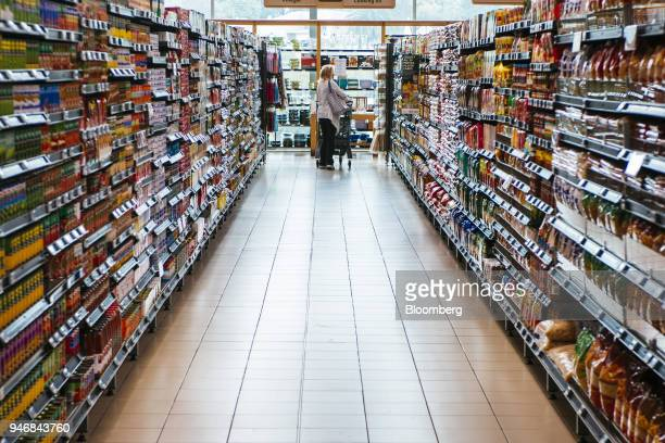 A customer pushes a shopping cart inside a Pick n Pay Stores Ltd supermarket in Johannesburg South Africa on Monday April 9 2018 As trade tensions...