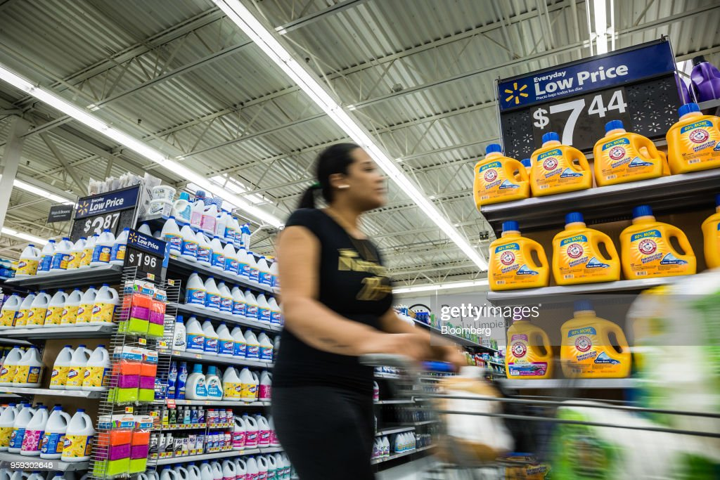 A customer pushes a shopping cart past laundry detergent bottles on display for sale at a Walmart Inc. store in Secaucus, New Jersey, U.S., on Wednesday, May 16, 2018. Walmart is scheduled to release earnings figures on May 17. Photographer: Timothy Fadek/Bloomberg via Getty Images