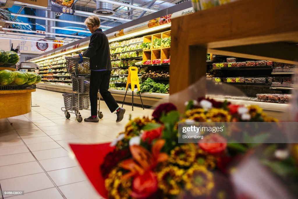 A customer pushes a shopping cart through the fresh produce aisles inside a Pick n Pay Stores Ltd. supermarket in Johannesburg, South Africa, on Monday, April 9, 2018. As trade tensions and the Syrian conflict roiled markets this month, South Africas rand has been stuck in an unusually narrow range for one of the worlds most volatile currencies. Photographer: Waldo Swiegers/Bloomberg via Getty Images