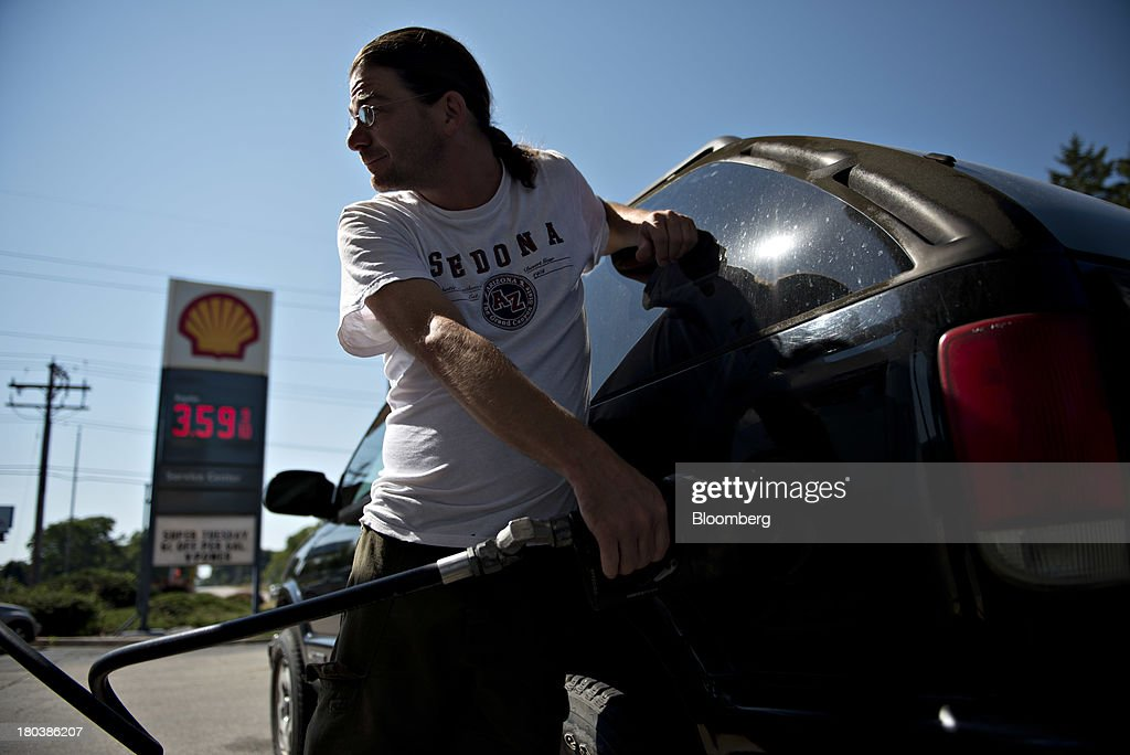 A customer puts fuel in his vehicle at a Shell gas station in Peoria, Illinois, U.S., on Wednesday, Sept. 11, 2013. Gasoline climbed in New York trading as crude advanced before talks between the U.S. and Russia over disposing of Syrias chemical weapons and as U.S. jobless claims dropped. Photographer: Daniel Acker/Bloomberg via Getty Images