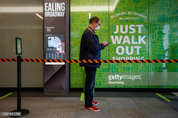 Customer queues to shop at the Amazon.com Inc. Amazon Fresh cashierless convenience store in the Ealing area of London, U.K., on Thursday, March 4,...