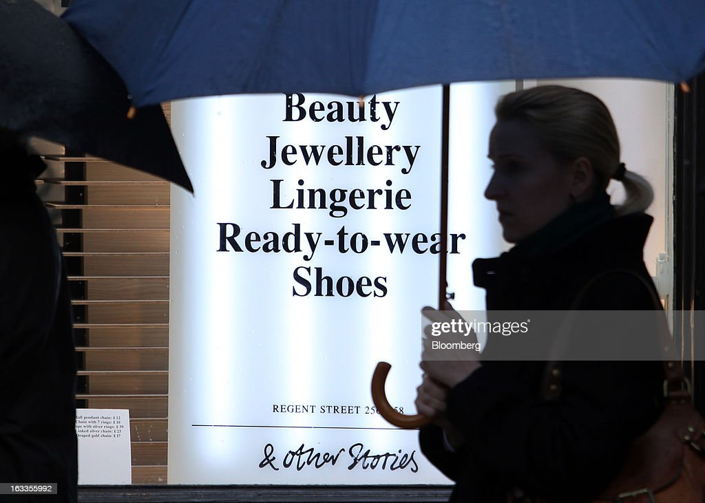 A customer queues up outside the new '& Other Stories' store operated by Hennes & Mauritz AB (H&M) on the launch day in London, U.K., on Friday, March 8, 2013. The Swedish retailer is diversifying with a sixth brand after falling behind larger competitor Inditex SA in the race for the price-sensitive fashionista's euro. Photographer: Chris Ratcliffe/Bloomberg via Getty Images
