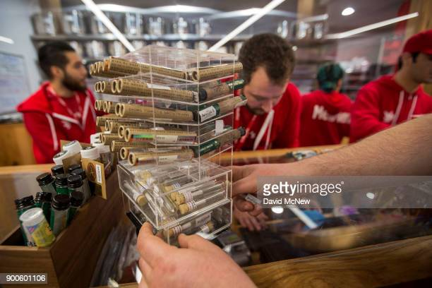 A customer reaches for cannabis products at MedMen one of the two Los Angeles area pot shops that began selling marijuana for recreational use under...