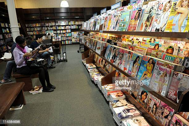 Customer read magazines in a Barnes Noble Inc store in New York US on Tuesday May 24 2011 Barnes Noble Inc the target of a $1 billion bid from...