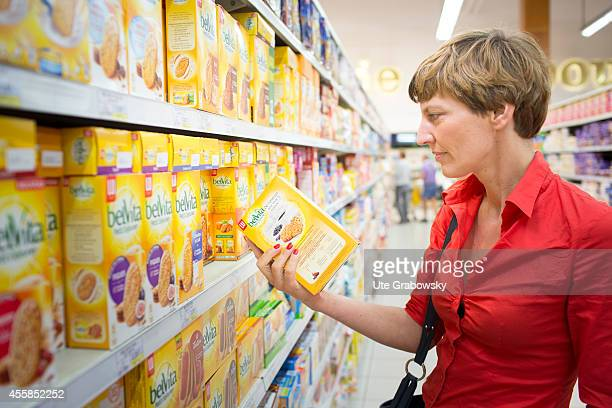 Customer reading the list of ingredients of a product in a French supermarket on July 21 in Moullin France