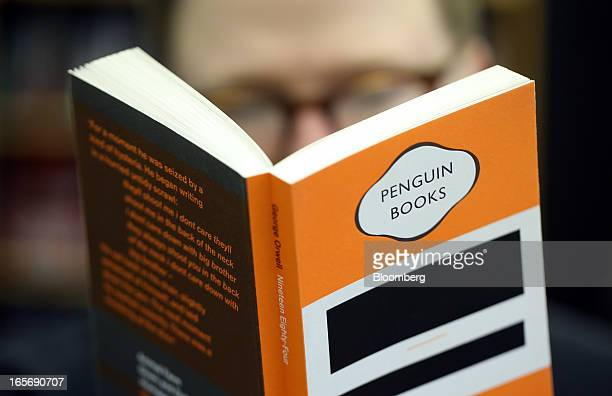 A customer reads a copy of 1984 by George Orwell published by the Penguin publishing house part of Pearson Plc at a bookstore in London UK on Friday...