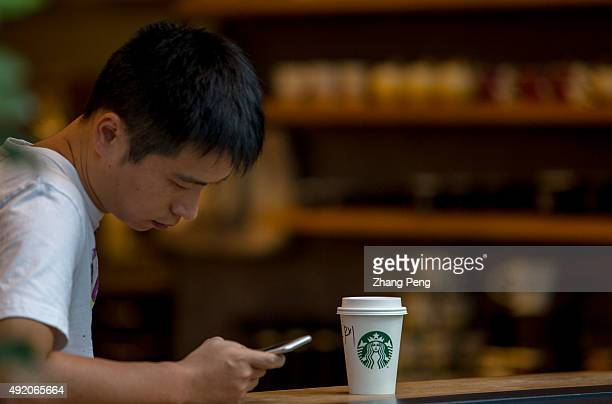 Customer reads mobile phone in Starbucks cafe On October 7 Starbucks Corp named Adobe Systems Inc executive Gerri MartinFlickinger to the newly...