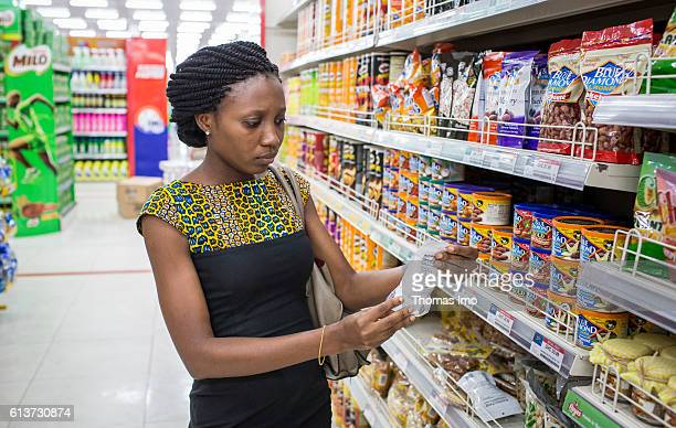 Customer reads the information on a product packaging during her shopping at the Palace supermarket on September 08, 2016 in Accra, Ghana.