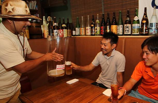a customer c receives a large beer mug 25cm in diameter and 45cm in tall from a restaurant owner in tsukuba suburban tokyo on july 25 2015 to protest - Large Restaurant 2015