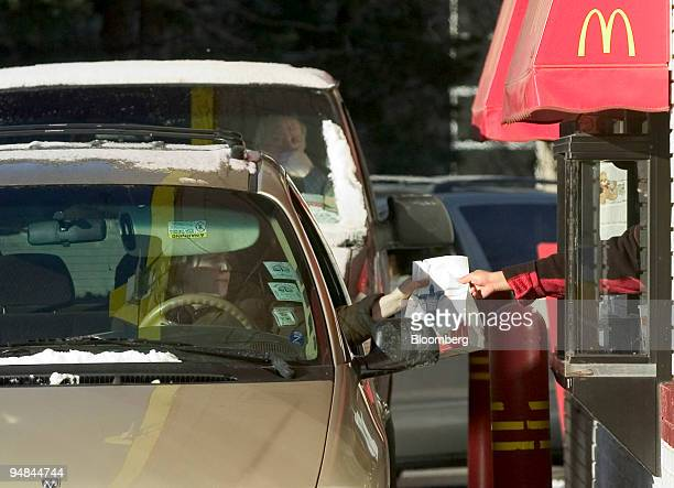 A customer receives her order at a driveup window at a McDonald's restaurant in Evanston Illinois on Thursday January 27 2005 McDonald's Corp the...
