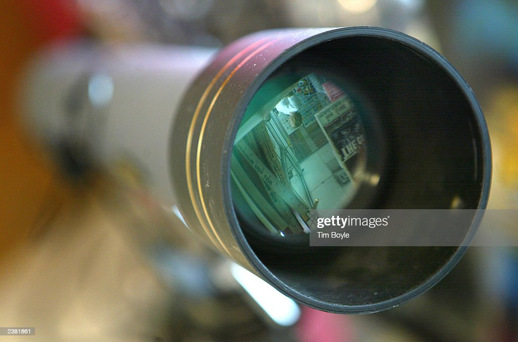 A customer reflected in the lens of a galileo telescope is seen
