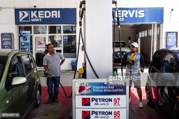 Customer refuel their car at a Petron Corp gas station in Kota Kinabalu Sabah Malaysia on Sunday July 30 2017 Sabah and neighboring Sarawak are known...
