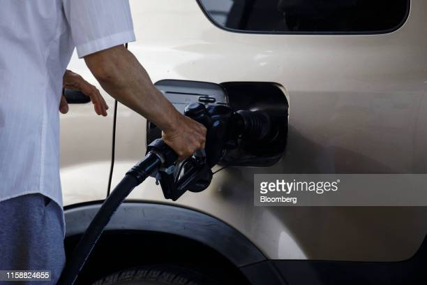 A customer refuels a vehicle at a Royal Dutch Shell Plc gas station in Redondo Beach California US on Sunday July 28 2019 Royal Dutch Shell is...