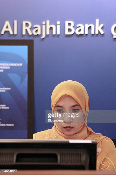 A customer relations officer is seen working at the Al Rajhi Bank in Kuala Lumpur Malaysia on Monday Feb 5 2007