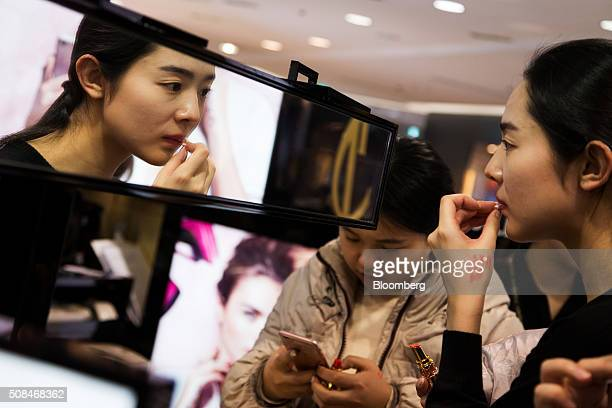 A customer removes lipstick at a cosmetics booth in a Hotel Lotte Co Duty Free store in Seoul South Korea on Thursday Feb 4 2016 Hotel Lotte the...