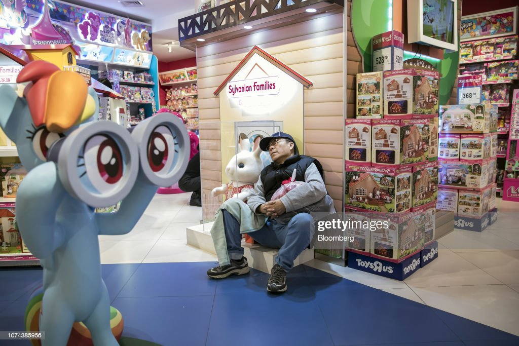 A Customer Rests Against A Display Inside A Toys R Us Asia Store