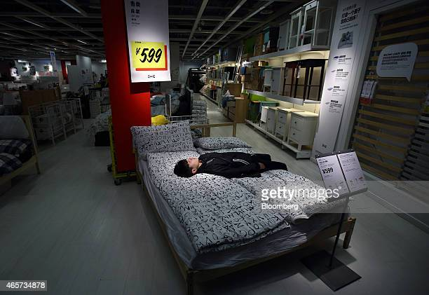 A customer rests on a bed inside the Ikea Beijing Xihongmen Store operated by Ikea AB in Beijing China on Monday March 9 2015 China's consumer prices...