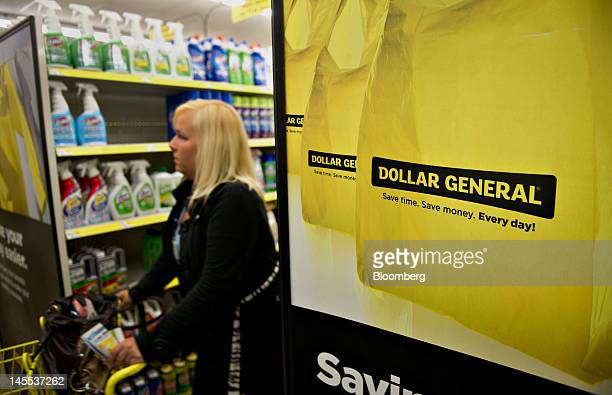 Customer Savanna Bohm shops at a Dollar General Corp store in Creve Coeur Illinois US on Thursday May 31 2012 US consumer spending rose in April a...