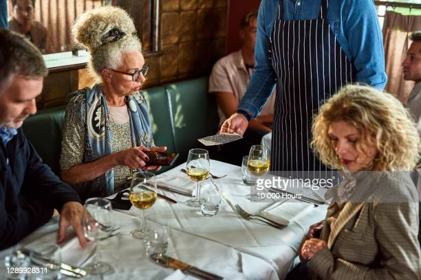 customer scanning online menu on smartphone - showing stock pictures, royalty-free photos & images