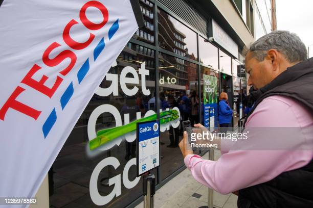 Customer scans a QR code outside at the Tesco Plc cashierless concept store, called GetGo, on its opening day at a Tesco Express in High Holborn,...