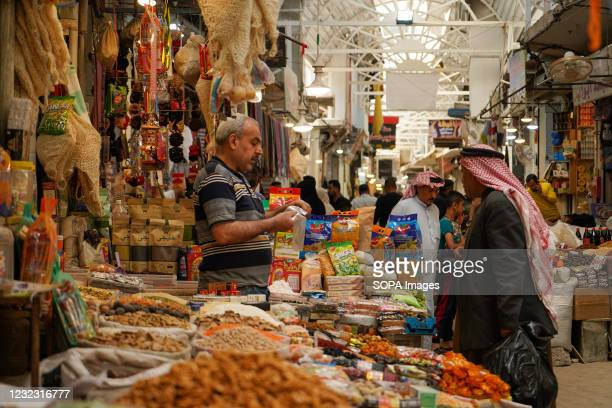 Customer seen buying spices from a seller in Bab Al-Saray market during the Muslim holy month of Ramadan.