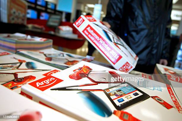 A customer selects a catalogue inside an Argos store operated by Home Retail Group Plc in Enfield UK on Wednesday Sept 7 2011 Home Retail Group Plc...