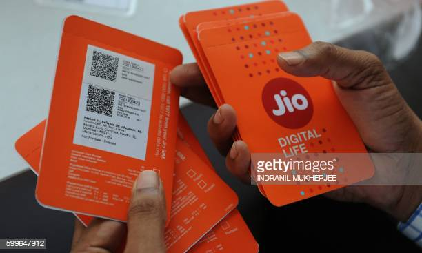 A customer selects his number of Reliance Jio Infocomm 4G mobile services in Mumbai on September 6 2016 India's richest man Mukesh Ambani has...