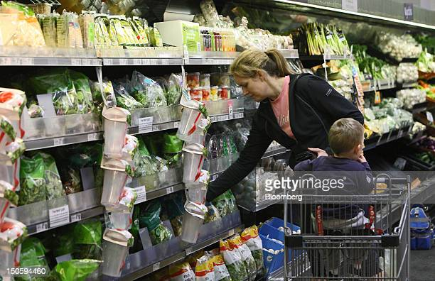A customer selects vegetables at a Woolworths Ltd supermarket in Perth Australia on Wednesday Aug 22 2012 Woolworths Australia's largest retailer is...