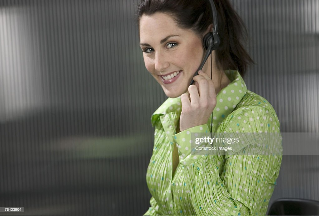 Customer service agent with headset : Stockfoto