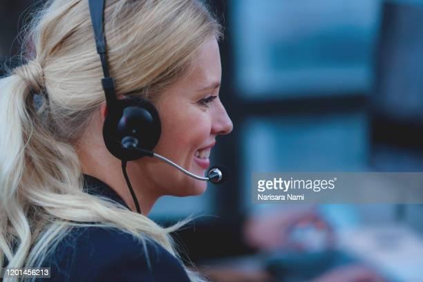 customer service agent  woman with headset working in a call center. - dienstverlening stockfoto's en -beelden