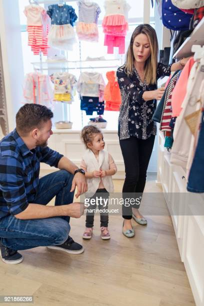 Customer service for father and daughter in a children store.
