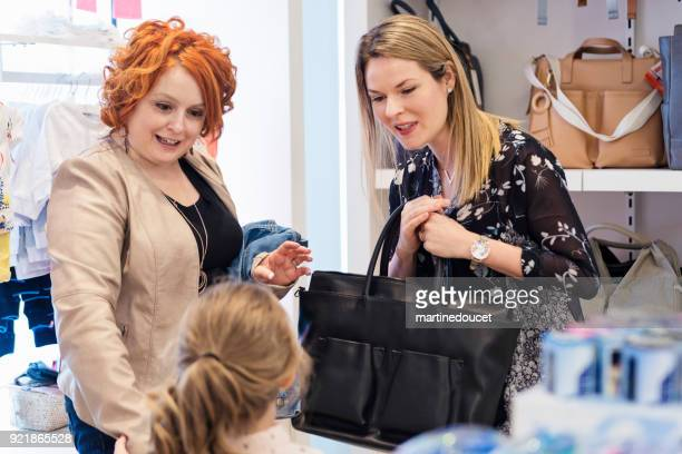 """customer service for mother and daughter in a children store. - """"martine doucet"""" or martinedoucet stock pictures, royalty-free photos & images"""