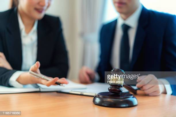 customer service good cooperation, consultation between a businessman and male lawyer or judge consult having team meeting with client, law and legal services concept. - 検察官 ストックフォトと画像